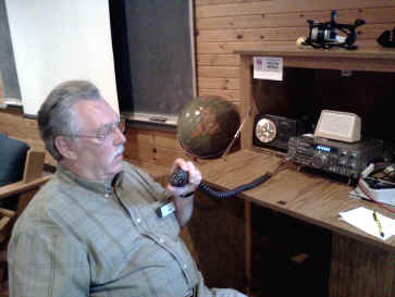 Bill, N0CIC, checks out the venerable Kenwood TS-440 at Courage North, in the Op Skills room.