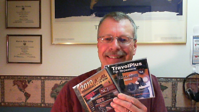 Pat, WA0TDA, holds up new ARRL Periodicals and TravelPlus CDs