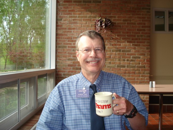 Pat, WA0TDA, with handiham coffee mug.
