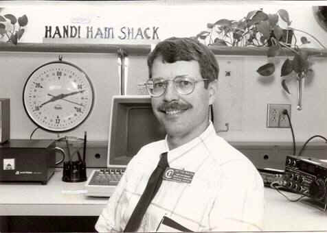 Black & white photo of Pat Tice, WA0TDA, in the Handiham shack in 1991.