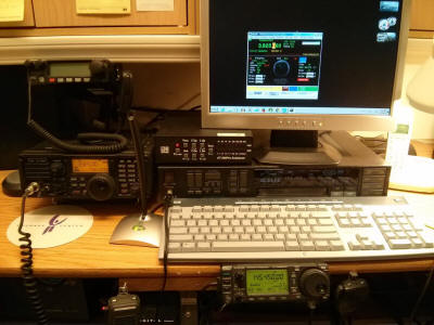 Ham station at WA0TDA.  IC-7200, LDG tuner, IC-706M2G, monitor showing IRB station