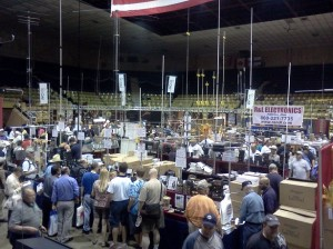 Pictured: A view of the main arena at the HARA facility.  Amateur Radio manufacturers, publishers, and dealers fill this space with some amazing goods and services - anything you might need to set up your station. Look at all the antennas in this photo!  It's a good thing the arena has a really high ceiling.