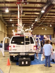 "Red Cross communication vehicle with extended mast for antennas."" width="