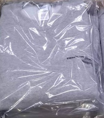 Photo of stack of new gray sweatshirts with the Handiham Logo embroidered on them.