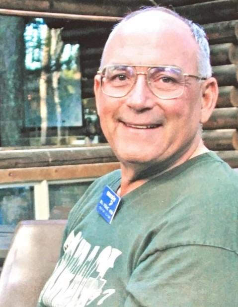 Photo of a smiling Bill Vokac, K9BV, at one of the Handiham Radio Camps he loved so much