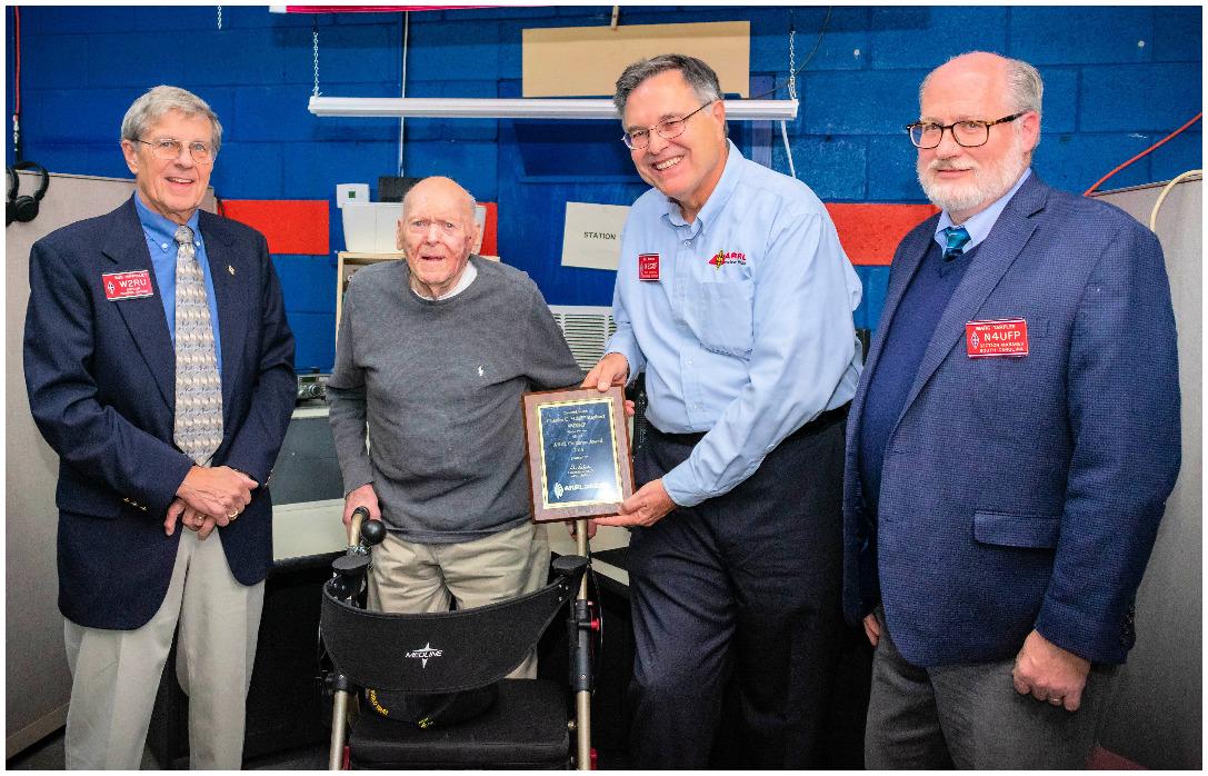 photo of Cliff Kayhart receiving the ARRL Centurion Award.