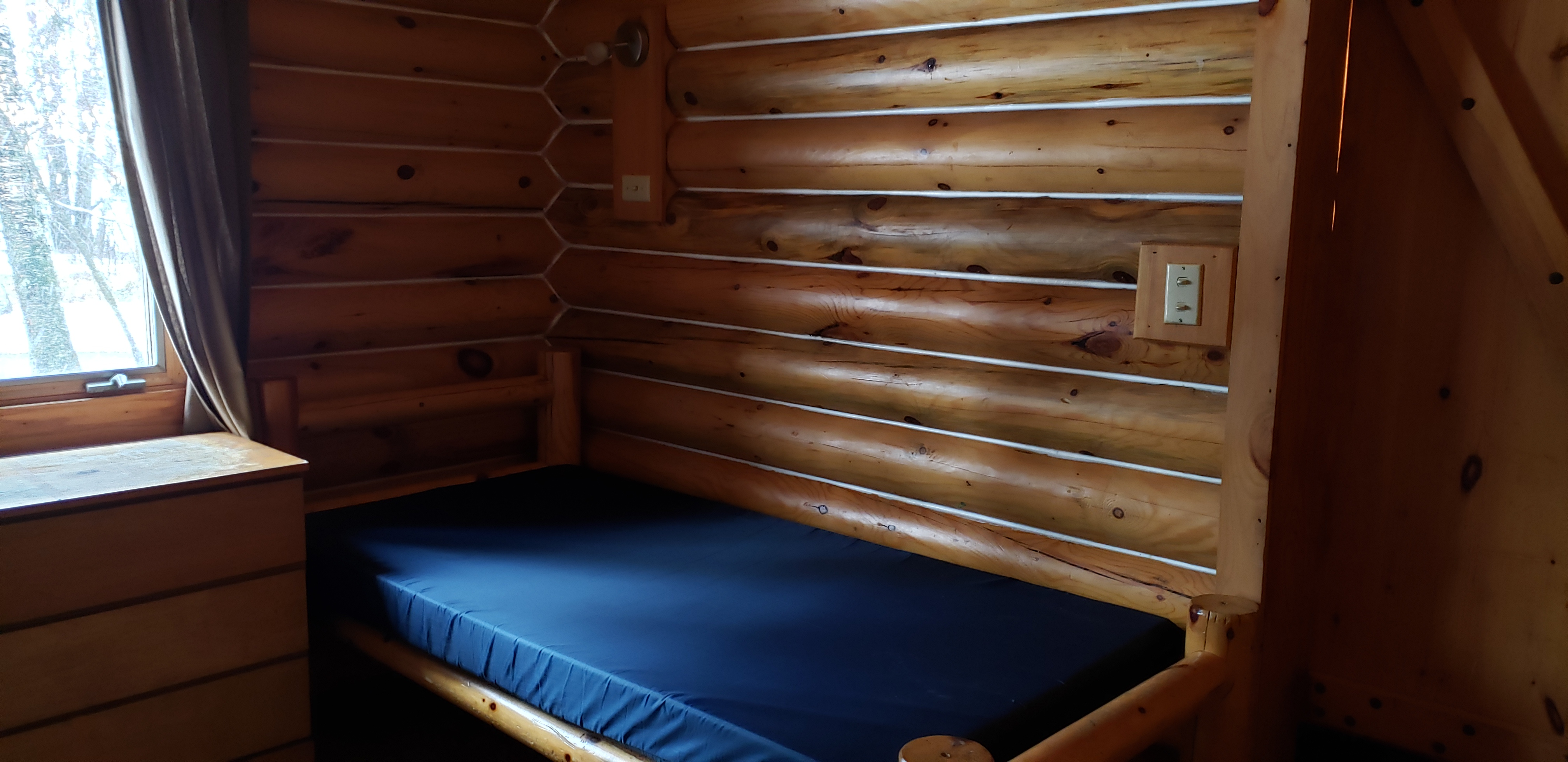 Photo of Camp Courage North bunk in one of the lovely log cabins.