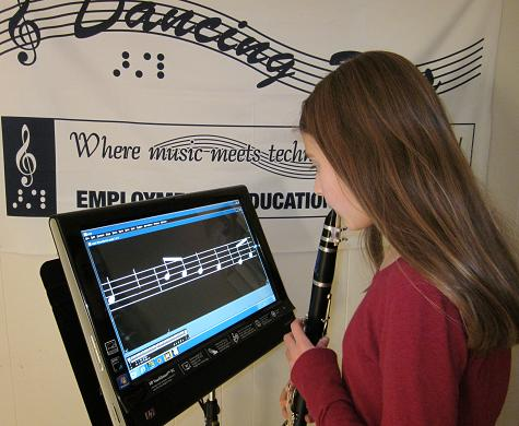 photo of girl playing clarinet using accessible music software