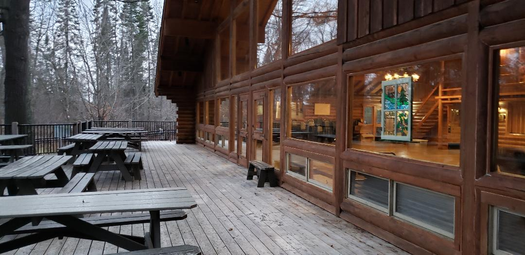 Photo of the Camp Courage North Dining Halls Deck with picnic tables.