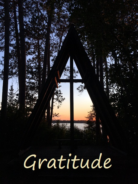 Photo of Camp Courage North chapel at sunset with the word Gratitude across the bottom.