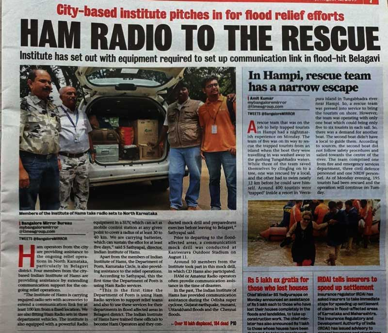 Photo of newspaper with article about hams assisting with the flood rescue