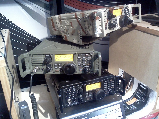 Stack of three IC-7200 transceivers, one in plain black, one in army green, and one in camo paint.