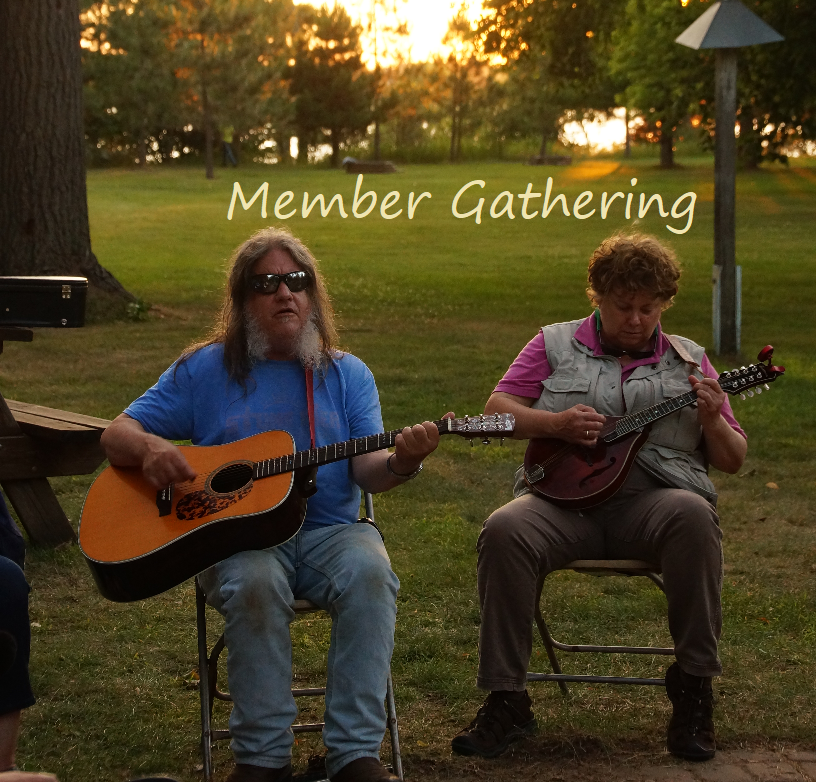Photo of jam session around the campfire at Radio Camp 2019 with Matt and Lynelle and the words Member Gathering.