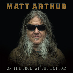 "photo of Matt Arthur on the cover of his 2018 CD, On the Edge,at the Bottom."" width="