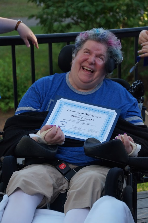 photo of Diane receiving her Radio Camp 2019 certificate