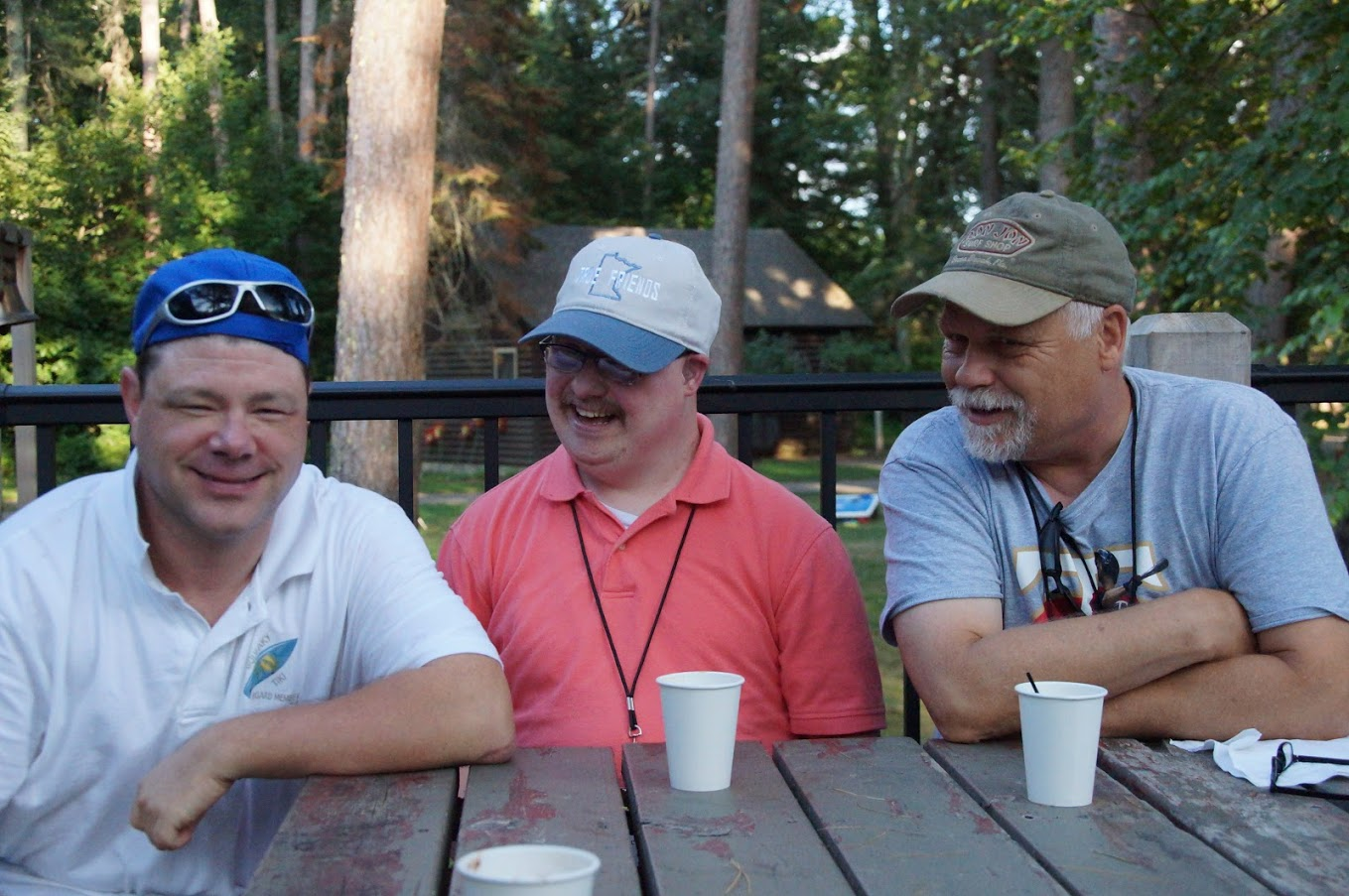 photo of Nick, Scott, and Ron on the deck of the dining hall
