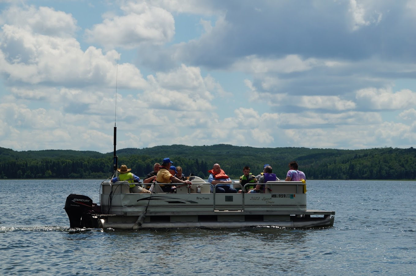 Photo of radio campers out on the pontoon boat on Lake George.