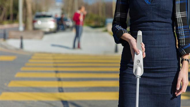 Photo of WeWalk smart cane.