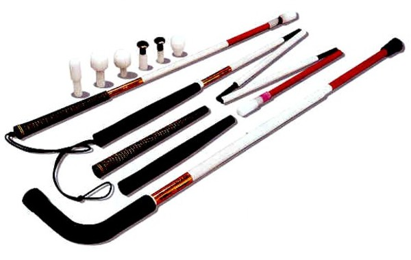 Photo of many different types and lengths of white canes.