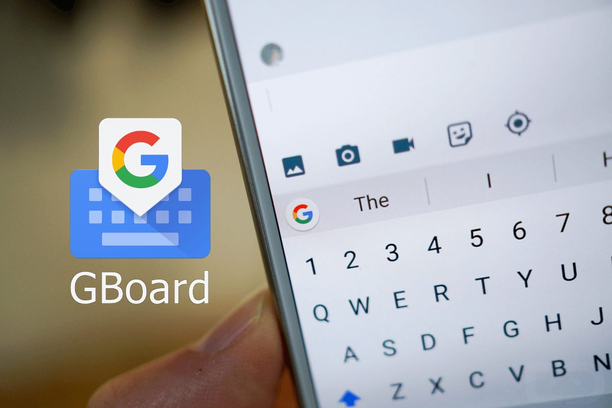 Photo of Google keyboard held in a person's hand.