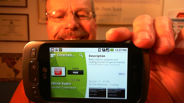Pat, WA0TDA, holds up Android phone showing free iBlink Radio application in the Android Market.