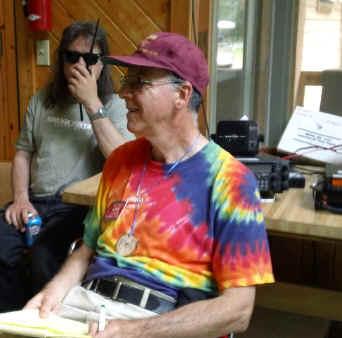 Matt, KA0PQW, talks on an HT while Phil, K9HI stands by.