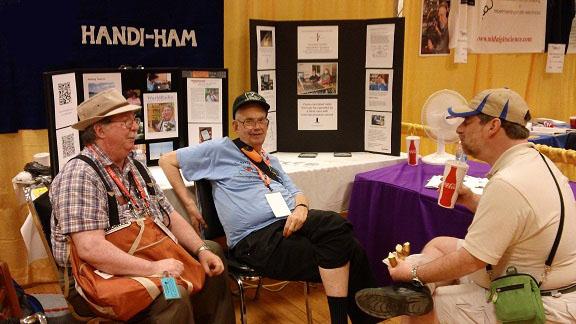 Larry, KA0LSG, John, N0BFJ, and Ken, KB3LLA, on booth duty.