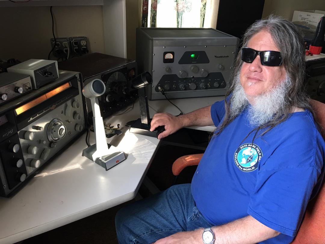 Matt Arthur with his AM station.  The big transmitter the Heathkit DX-100, next to that is the Johnson Viking Ranger.<br />Then there is the National NC-303 receiver.  There is also some other stuff like the crystal calibrator and swr power<br />meter and stuff.