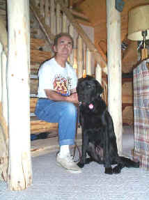 Photo of the Jerry and his guide dog at his cabin.