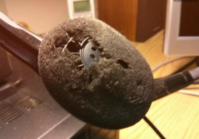 Close up of torn earpiece foam cover on headset